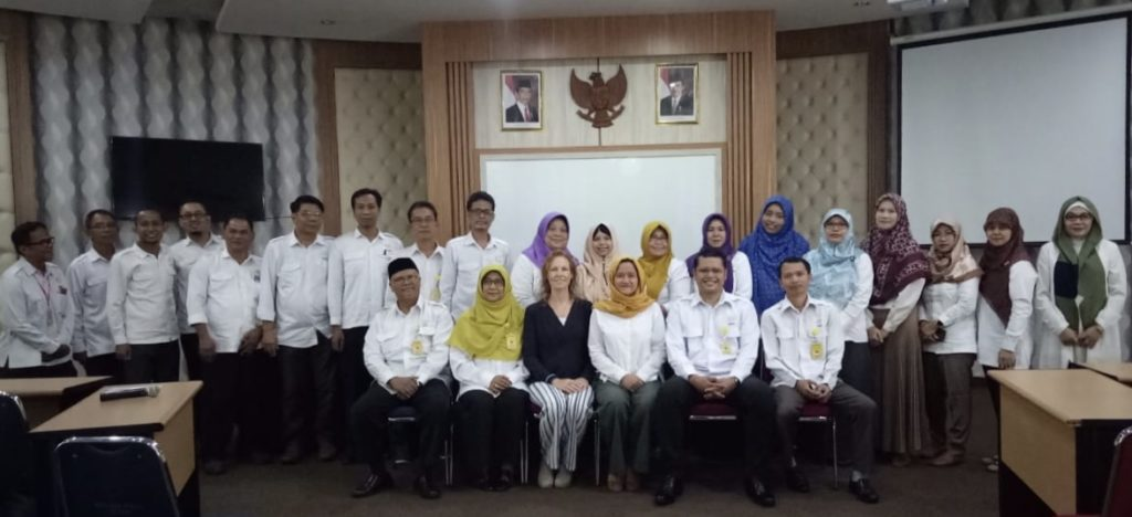 A group photo of the Dean, Vice Deans, and Department heads from FBS, with me and Puji in the front/center