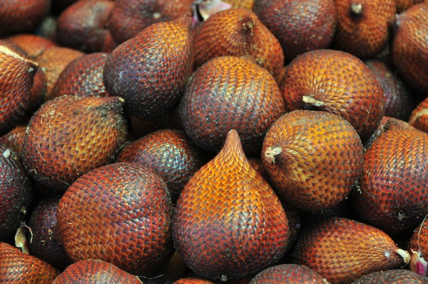 a pile of salak, also known as snake fruits